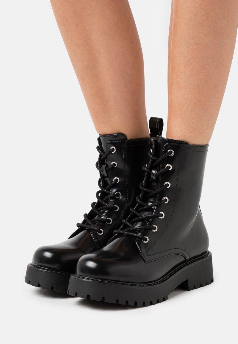 Monki - VEGAN LEANDRA BOOT - Platform ankle boots - black