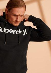 Superdry - Hoodie - black - 2