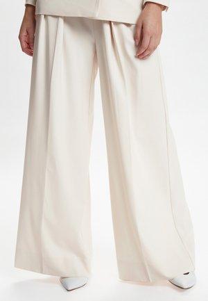 ABRA - Trousers - beige
