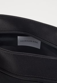 Calvin Klein Jeans - FLATPACK - Across body bag - black - 4