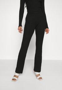 Glamorous - KNITTED MARL FLARES - Kalhoty - black - 0