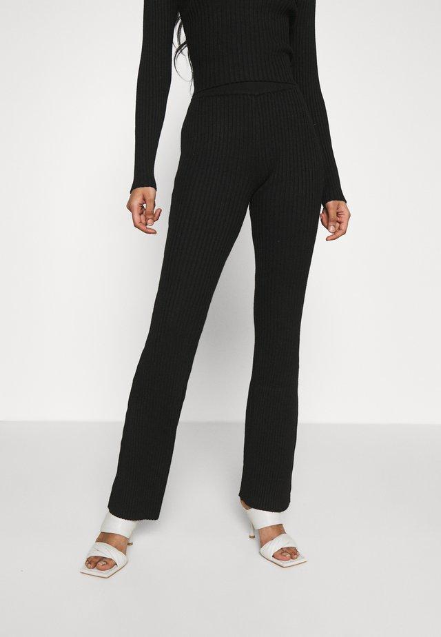 KNITTED MARL FLARES - Pantalones - black