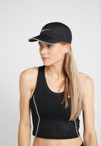 Nike Performance - AERO UNISEX - Lippalakki - black - 5