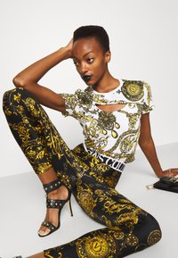 Versace Jeans Couture - PANTS - Legginsy - black/gold - 4
