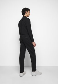 KARL LAGERFELD - PANTS - Tracksuit bottoms - black - 2