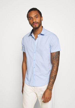 MOMBASSA - Shirt - pale blue/dk navy