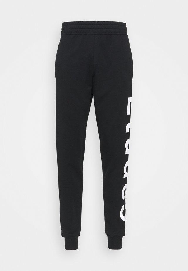 TEMPERA UNISEX - Pantalon de survêtement - black