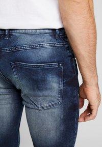 Redefined Rebel - STOCKHOLM TERRY - Slim fit jeans - dark sea - 3