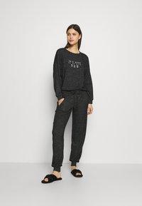 Marks & Spencer London - COSY CUFF PANT - Pyjama bottoms - black - 1