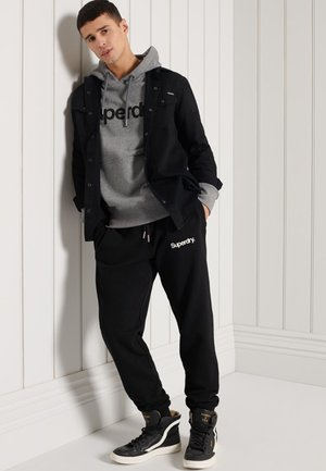 LIGHTWEIGHT MILITARY GRAPHIC - Tracksuit bottoms - black