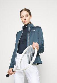 J.LINDEBERG - KATI GOLF MID LAYER - Fleece jacket - orion blue - 4