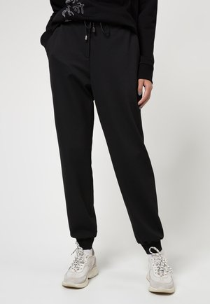 HELEAS - Tracksuit bottoms - black
