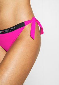 Tommy Hilfiger - CORE SOLID LOGO CHEEKY SIDE TIE - Bikini bottoms - pink glo - 4