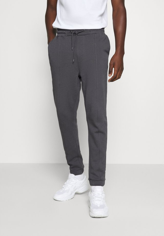 Loose Fit UNISEX - Tracksuit bottoms - dark grey