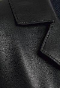 STUDIO ID - PAULINE CONTRAST POCKET COAT - Kožená bunda - black - 4