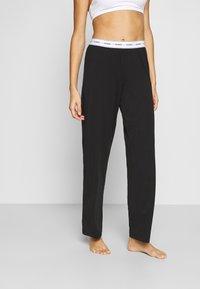 Guess - LONG PANT - Pyjama bottoms - jet black - 0