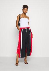 Champion Reverse Weave - WIDE LEG PANTS - Tracksuit bottoms - black - 1
