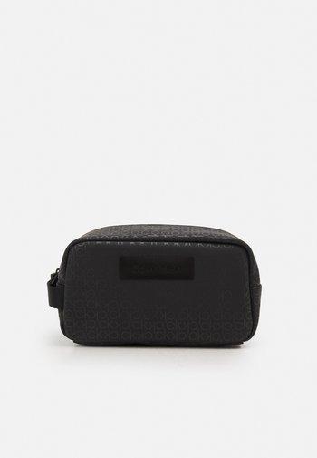 WINTER PROOF WASHBAG UNISEX - Wash bag - black