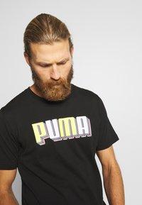 Puma - CELEBRATION GRAPHIC TEE - T-shirt imprimé - black - 4