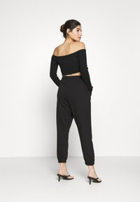 Missguided Petite - PRIDE JOGGERS - Tracksuit bottoms - black - 2