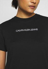 Calvin Klein Jeans - INSTITUTIONAL DRESS - Žerzejové šaty - black - 6