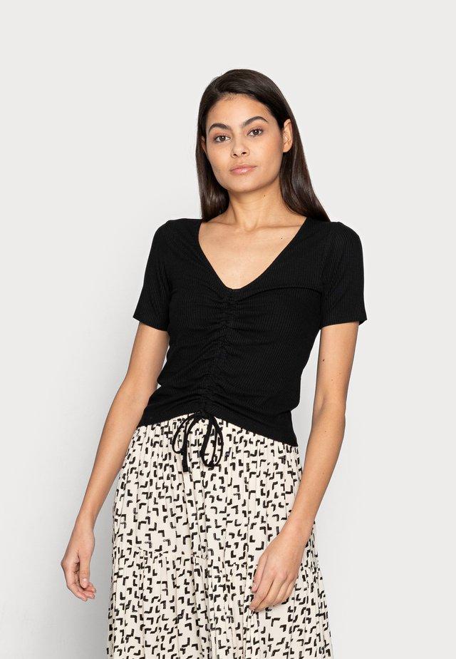 TOP DANIKA - T-shirt print - black