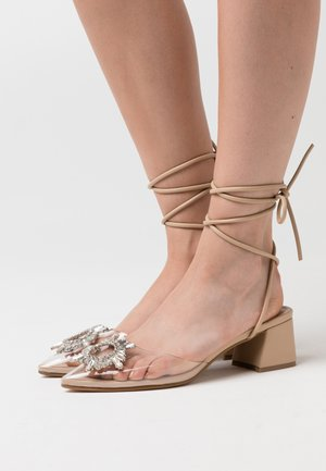 KINGY - Lace-up heels - clear/nude