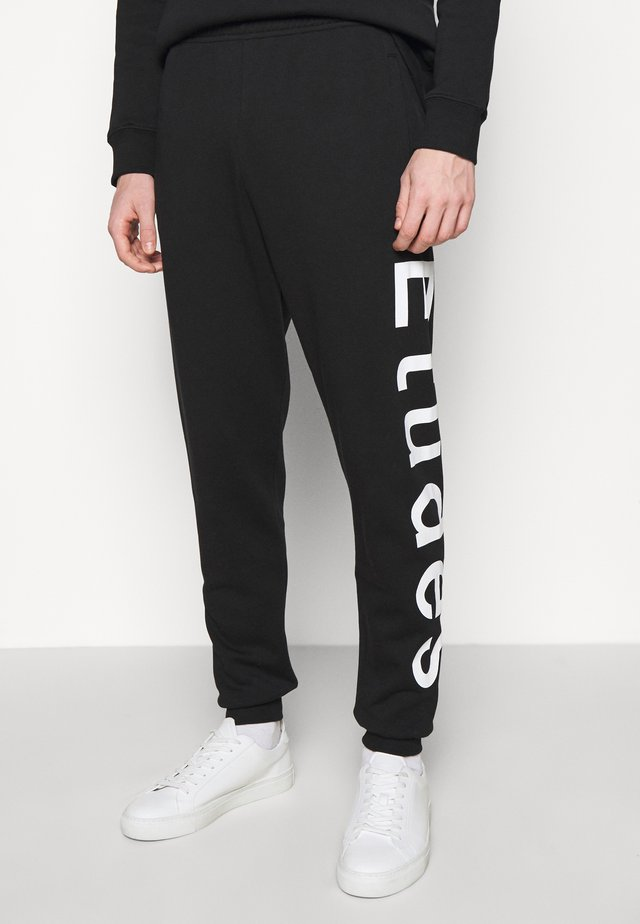 TEMPERA UNISEX - Trainingsbroek - black