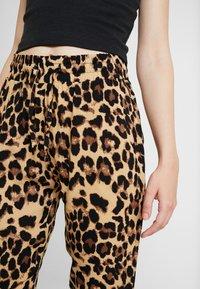 Urban Classics - LADIES ELASTIC WAIST PANTS 2 PACK - Trousers - black - 4