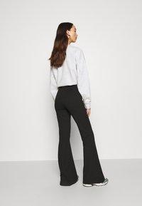 Monki - WILDA TROUSERS - Spodnie materiałowe - black - 2