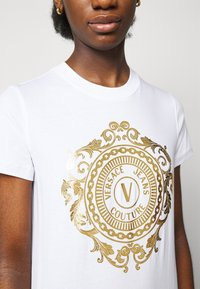 Versace Jeans Couture - DRESS - Jersey dress - optical white/gold - 5