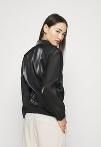 Nike Sportswear - AIR SHEEN - Summer jacket - black/white - 2