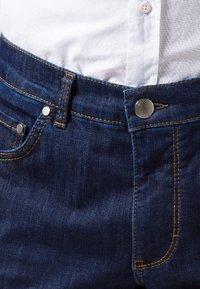 BRAX - STYLE COOPER  - Straight leg jeans - blue black - 4