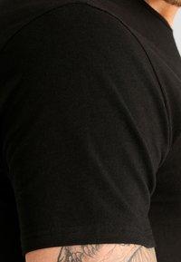 Calvin Klein Underwear - 2 PACK - Undershirt - black - 2