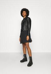 Tommy Jeans - TIERED LINE DRESS - Shirt dress - black - 1