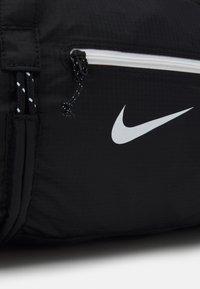 Nike Sportswear - UNISEX - Sportovní taška - black/white - 4