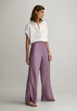 Spodnie materiałowe - mauve