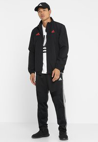 adidas Performance - TIRO - Pantalon de survêtement - black/white