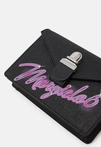 MM6 Maison Margiela - LOGO NEON ON TUC BAG SMALL - Bum bag - black - 5