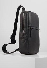 STUDIO ID - CROSSBODY BACK BAG - Sac bandoulière - black - 4