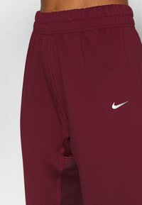 Nike Performance - PANT - Tracksuit bottoms - dark beetroot/metallic silver - 4