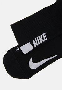 Nike Performance - 2 PACK UNISEX - Calcetines de deporte - black/white - 2
