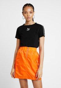 Puma - CLASSICS  - T-Shirt print - black - 0
