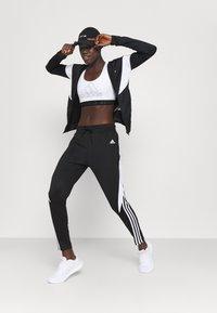 adidas Performance - COLORBLOCK - Tracksuit - black/white - 1