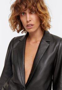 Uterqüe - Leather jacket - black - 3