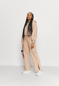 Puma - HER WIDE PANTS - Tracksuit bottoms - brush - 1