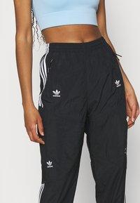 adidas Originals - TRACK PANTS - Tracksuit bottoms - black - 4