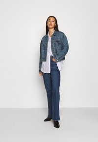 Levi's® - NEW HERITAGE TRUCKER - Veste en jean - blue denim - 1