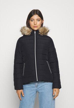 CORE PUFFER - Winter jacket - black beauty