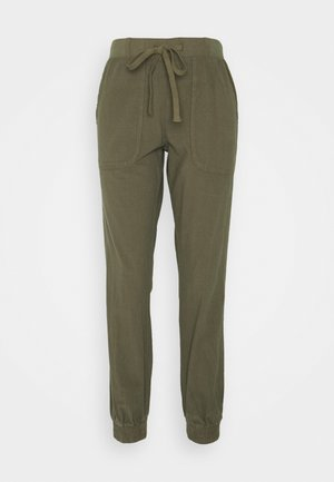 NAYA PANTS - Trousers - grape leaf